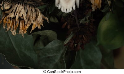 Skull fox in a bouquet of flowers wilted sunflower bouquet....