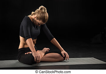 Woman sitting in lotus position - Woman performing Maha...