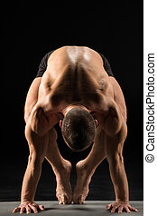 Man standing in yoga position - Young athletic man...
