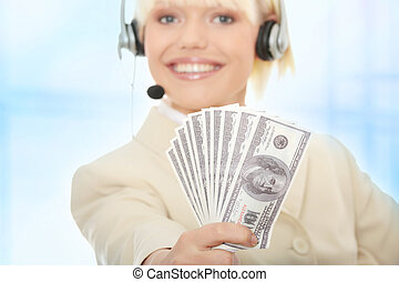 Business woman with headset holding dollars.Over abstract...