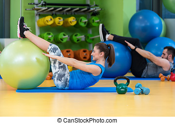 Group of people in a Pilates class at the gym.