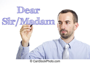 Dear Sir/Madam, - Young businessman writing blue text on...