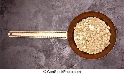 Coffee beans roast animation top view - Coffee beans are...
