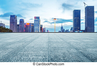 Modern city night view - Marble ground in front of city...