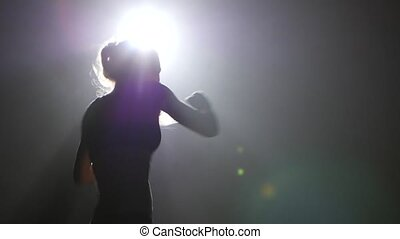 Champion boxer sends the punches. Silhouette. Black...