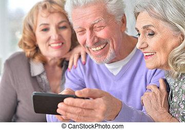 Elderly people using mobile phone