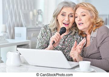 Elderly people singing karaoke