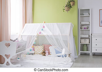 Playhouse with canopy in baby room - Rocking horse, crib and...