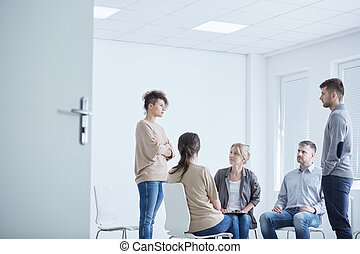 Psychodrama therapy session with young man and woman