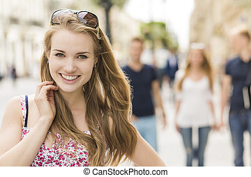 Smiling young woman with her friends - Close shot of smiling...
