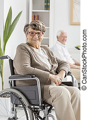 Woman on wheelchair - Elderly disabled woman on a wheelchair...