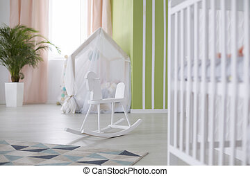 Crib and rocking horse - White crib and rocking horse in...