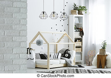 Child room with brick wall, lamps, bed and pattern carpet
