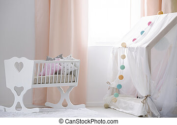 Crib and canopy playhouse in nursery