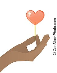 Hand holding candy on stick red heart on white