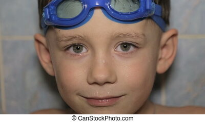 Portrait of a boy in glasses for swimming