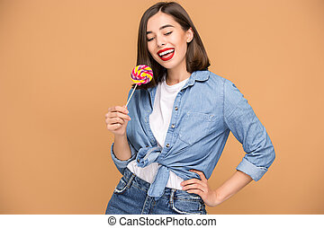 The young woman with colorful lollipop - young woman with...