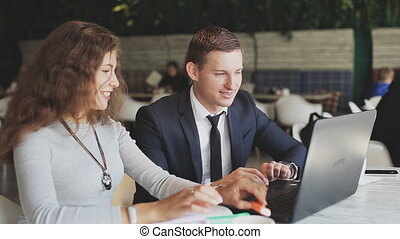 Business people working with laptop in cafe