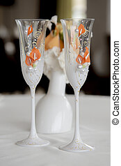 Two wedding glasses are on the table