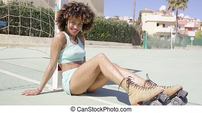 Young smiling woman on playground - Young fit girl in roller...