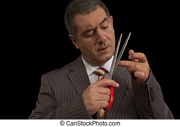 Businessman cutting nails - Businessman wearing suit,...