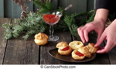 Plate with Home made Profiteroles stuffed by red caviar with...