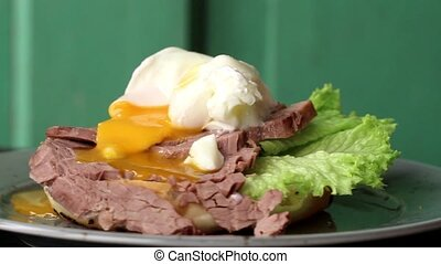 Rotating spotted plate with Homemade sandwich with baked...