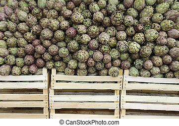 artichokes and boxes for sale at the grocery store -...