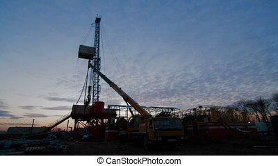 Timelapse Drilling Rig Oil Industry during Sunset - The Oil...
