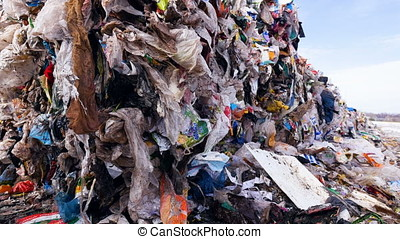 Plastic, packages, polyethylene in a garbage dump. Big piles...
