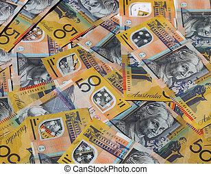 Closeup of many Australian 50 dollar notes.
