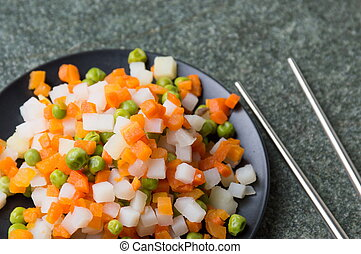 Cooked vegetables on a plate for making salad