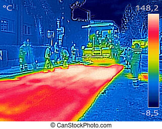 Infrared thermovision image Workers on Asphalting Road...