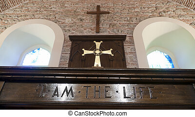 Crucifix over alter in church - Religion - Christianity -...