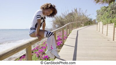 Female sitting on fencing - Smiling female wearing sportive...