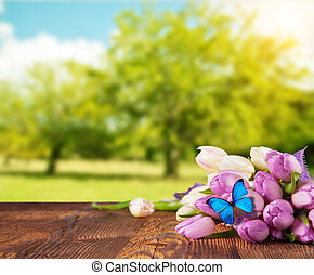 Spring tulip flower bouquet on wooden planks