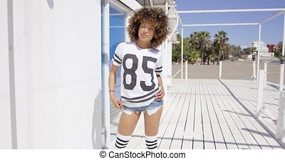 Female posing raising t-shirt, wearing sportive outfit,...