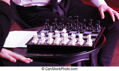 Game of chess by men - The hands of men play chess