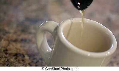 Pouring Coffee Into Mug on  Kitchen Counter Top