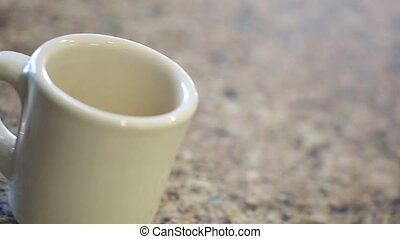 Panning Pouring of Coffee and Stirring Creamer Into Mug