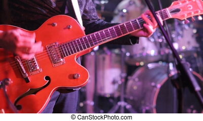 man plays the electric guitar in the club