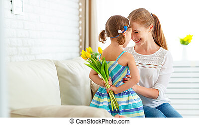 Happy mother's day! Child daughter congratulates moms and...