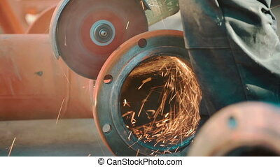 Worker grinds metal construction with circular saw - Worker...