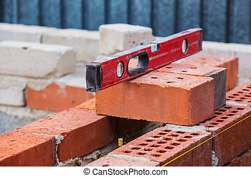 construction of  brick building building level on bricks
