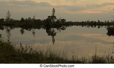 Reflections on the lake. Autumn sunset. Smooth dolly shot.