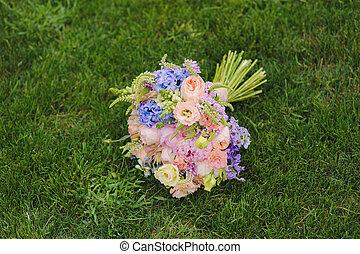 A wedding bouquet on the grass. Wonderful luxury wedding...