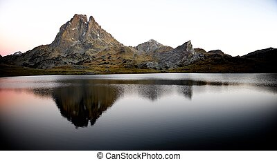 Pyrenees - Midi Dossau Peak reflected in Ayous lake. Ossau...