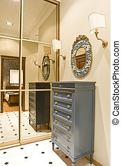 hall and cabinet with big mirror