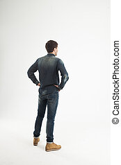 rear view of a stylish young man looking forward to the empty space