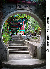 Chinese Garden - Archway feature and path leading to a...